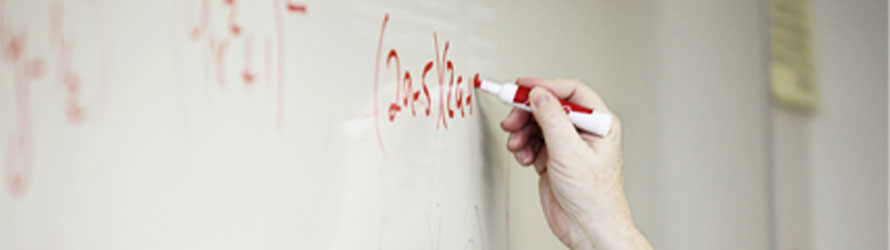 close up of someone writing on a whiteboard