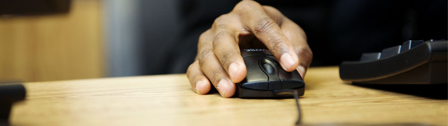 close up of a someone's hand using a mouse