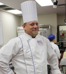 Chef Dave Moeller posing in the kitchen