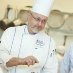 Chef David Woolums pointing something out in the kitchen