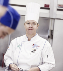 Chef Katie Payne in the kitchen with her students