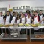several culinary students posing in the kitchen