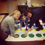 three people playing twister