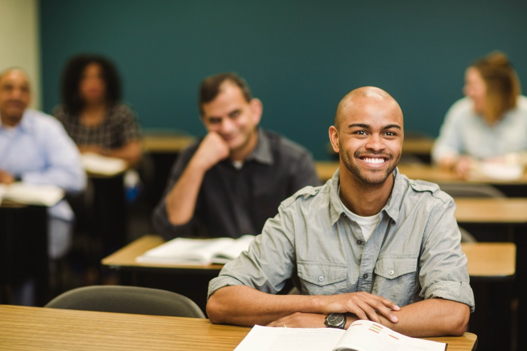 man smiling in class