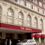 the outside entrance of the Brown hotel