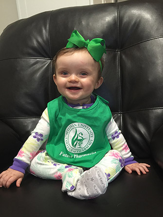 baby wearing a Sullivan University college of pharmacy future pharmacist bib