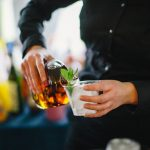 Pouring a mint julep at Taste of Derby