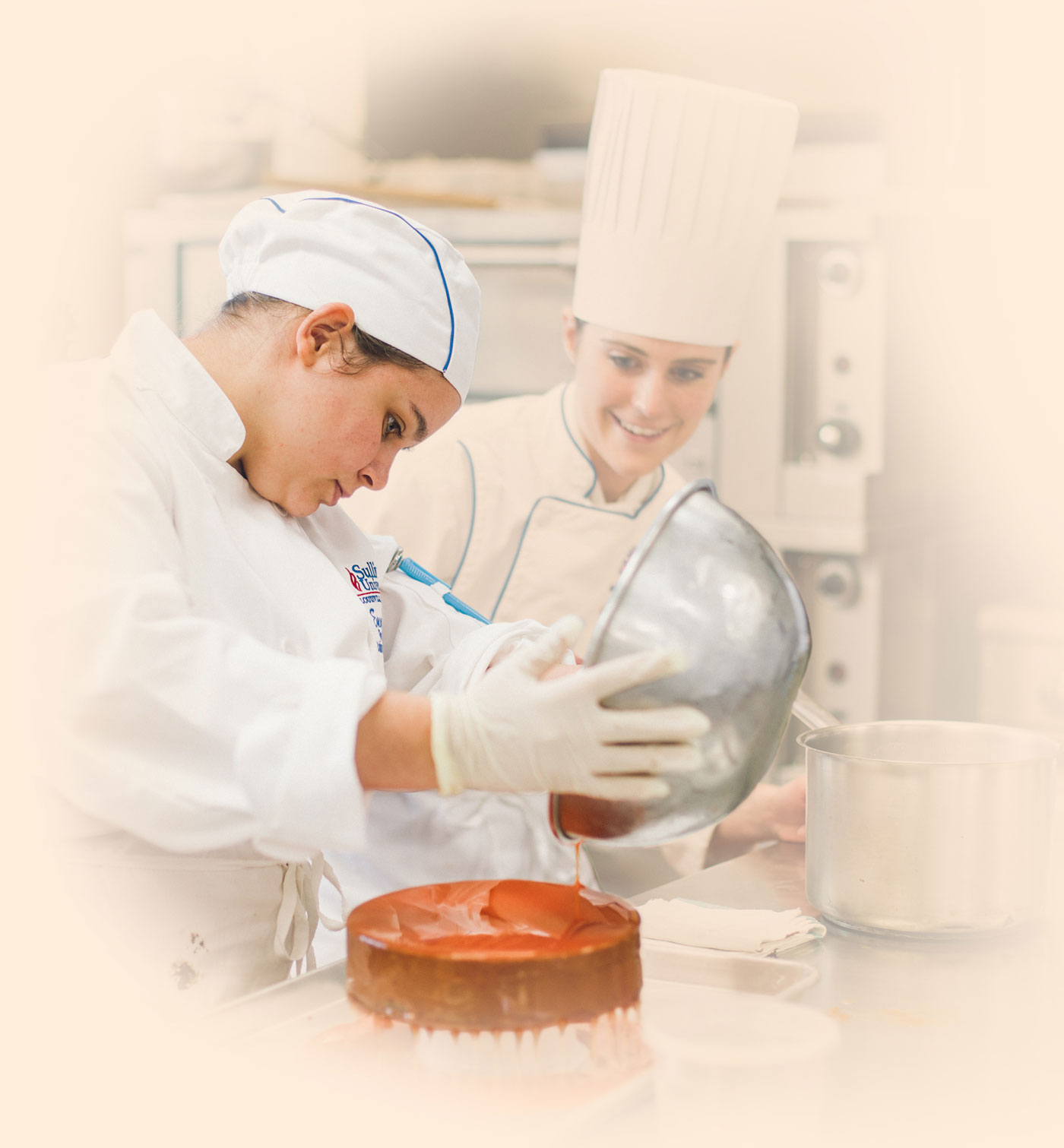 culinary student pouring a topping on a cake