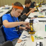 male student working on a robotics project