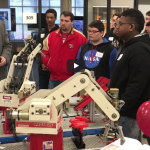 SULLIVAN'S COLLEGE OF TECHNOLOGY & DESIGN – DISCOVERY DAY DR. JOE BEDARD TEACHES VISITING HIGH SCHOOL STUDENTS ABOUT PROGRAMMING AND USING ROBOTS