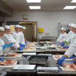Students at culinary camp working on food preparation.